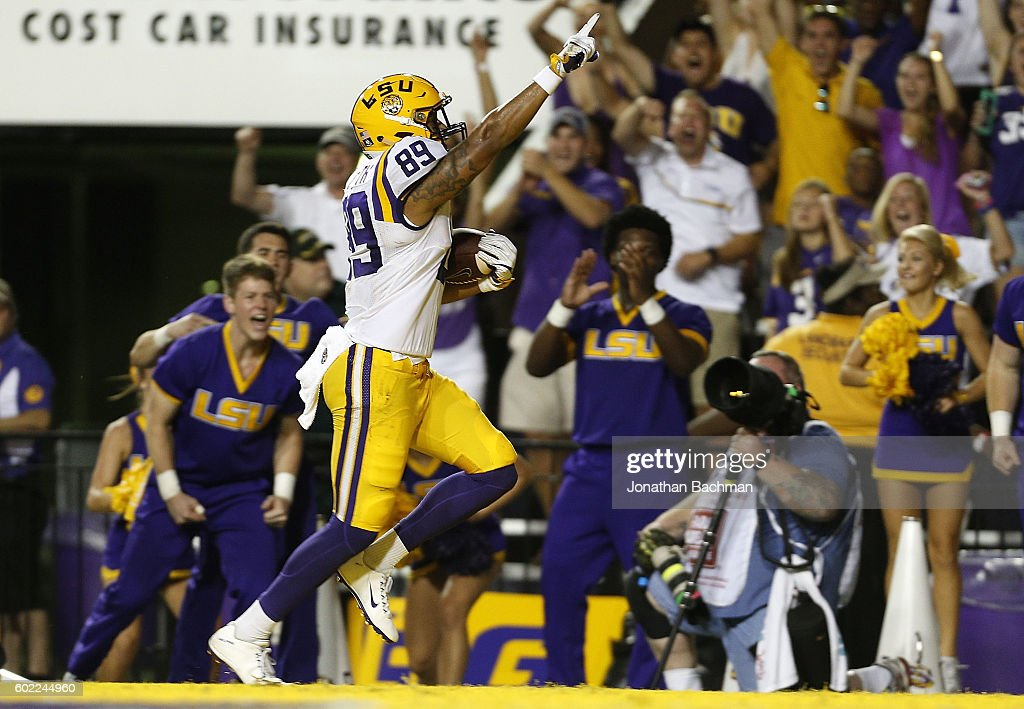 DeSean Smith #89 of the LSU Tigers scores a touchdown on a 46-yard reception during the first half of a game against the Jacksonville State Gamecocks at Tiger Stadium on September 10, 2016 in Baton Rouge, Louisiana.