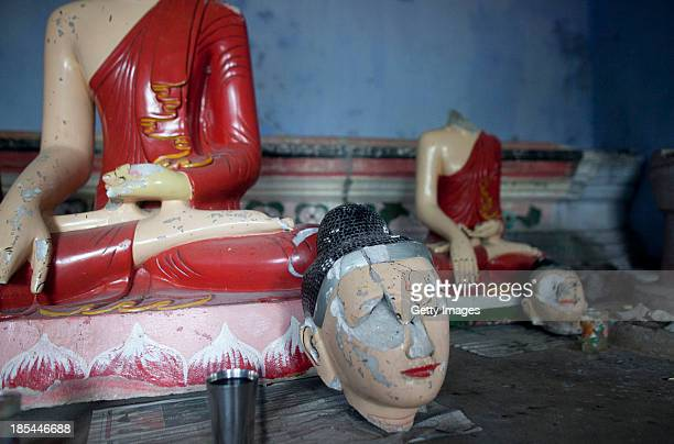 A desecrated idol that was damaged during last years attack lays in disrepair on the day of Probarona Purnima on October 19 2013 in Ramu Bangladesh...