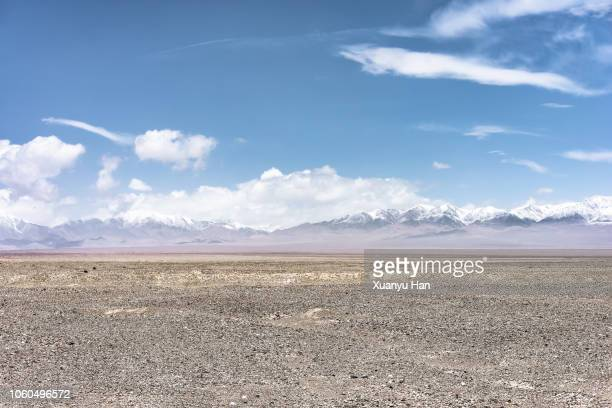desert and snow mountain - gobi desert stock pictures, royalty-free photos & images