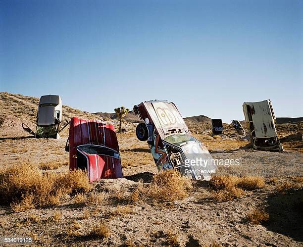 desert art installation with old cars - installation art stock pictures, royalty-free photos & images