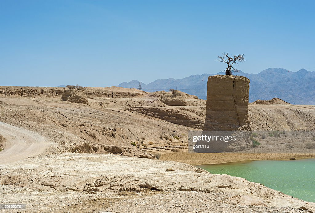 desert crater with water. : Stock Photo