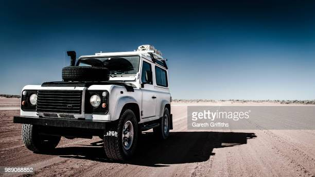 desert defender - 4x4 stock pictures, royalty-free photos & images