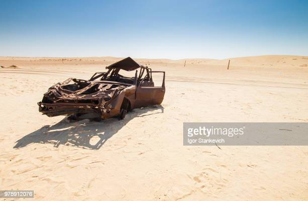 desert destroy, sahara - abandoned car stock photos and pictures