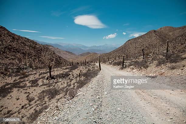 desert dirt road passing through mountains