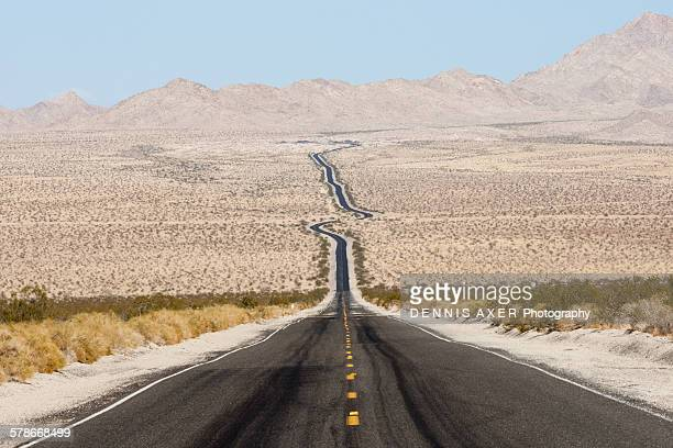 desert highway - nevada stock pictures, royalty-free photos & images