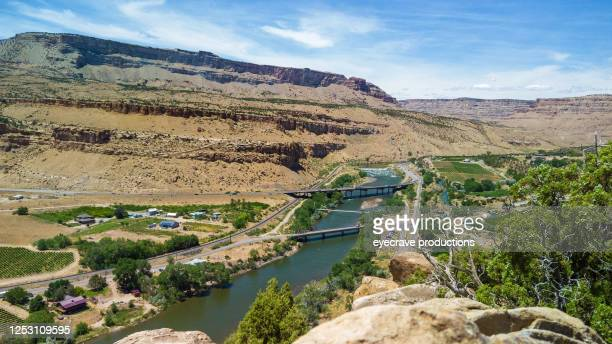 desert hike in early spring outdoor fitness activity palisade colorado overlook - colorado river stock pictures, royalty-free photos & images