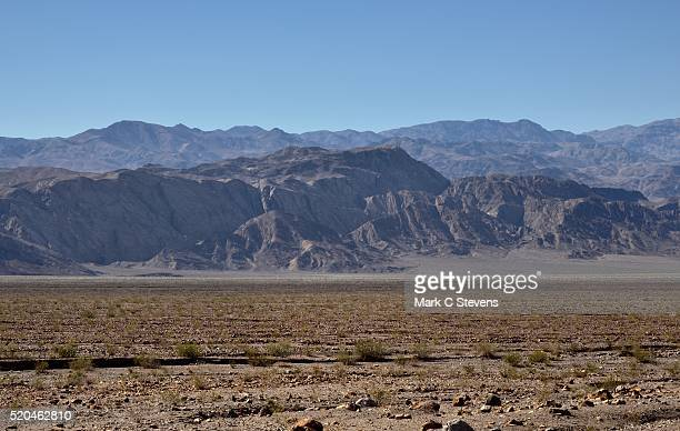 A Desert Landscape and Mountains Beyond