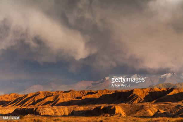 Desert landscape at sunset with storm clouds