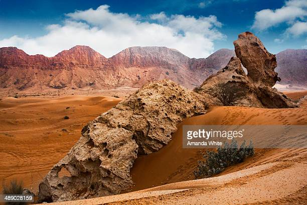 Desert Landscape of Camel Rock in Fujairah, United Arab Emirites. The Hajjar mountain range can been seen in the background.