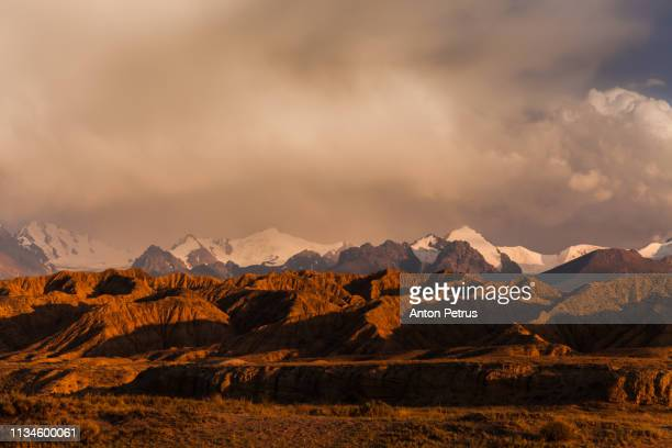 desert landscape with dramatic clouds at sunset - john day fossil beds national park stock pictures, royalty-free photos & images