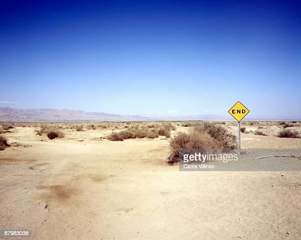 Desert landscape with end sign
