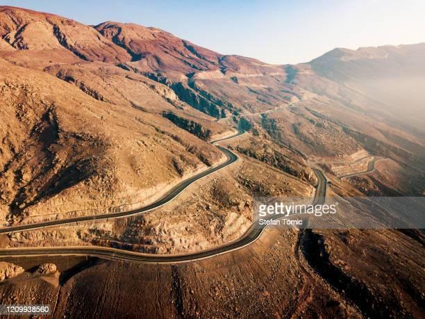 desert mountain road on the jais mountain in uae aerial view - ras al khaimah stock pictures, royalty-free photos & images