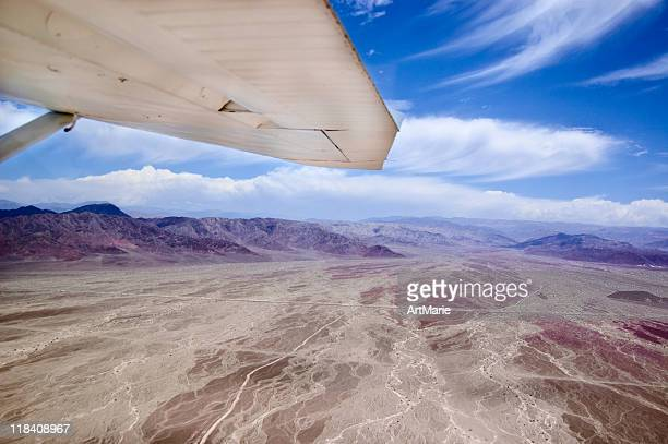 desert nazca under wing - nazca lines stock pictures, royalty-free photos & images