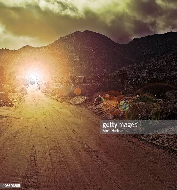 desert road and mountains with eerie light - ominous stock photos and pictures