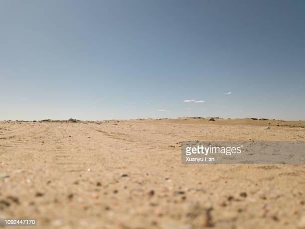 desert road, low angle view - land stock-fotos und bilder