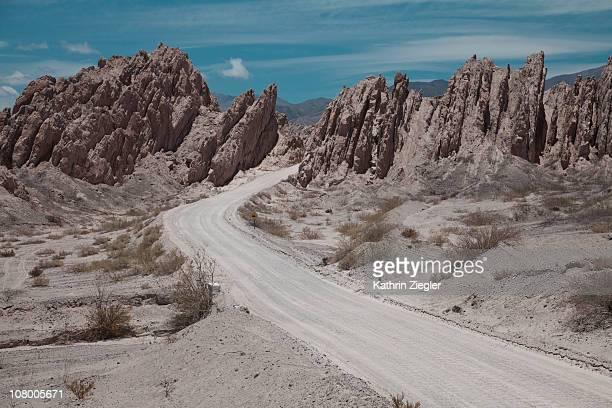 desert road passing through rock formation