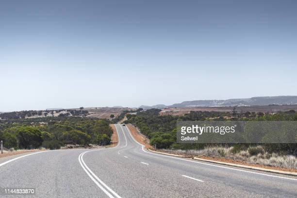 desert road - country road stock pictures, royalty-free photos & images