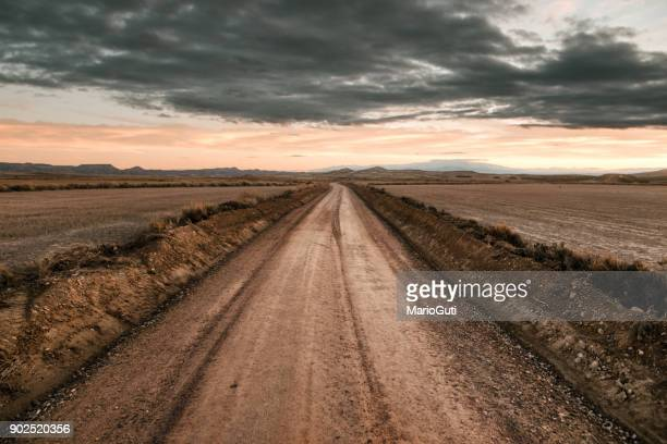 desert road - dirt track stock photos and pictures
