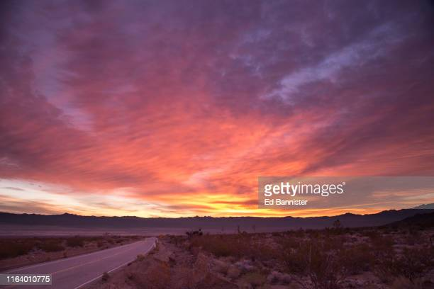 desert road solstice sunrise - winter solstice stock pictures, royalty-free photos & images