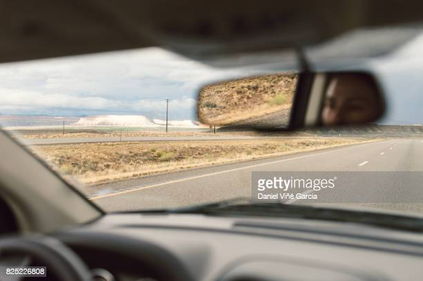 desert road, view through windscreen, utah, usa. - generic location stock pictures, royalty-free photos & images