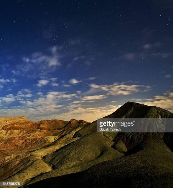 desert salt domes in moonlight - isfahan stock-fotos und bilder