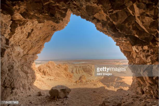 desert seen from cave - cave stock pictures, royalty-free photos & images