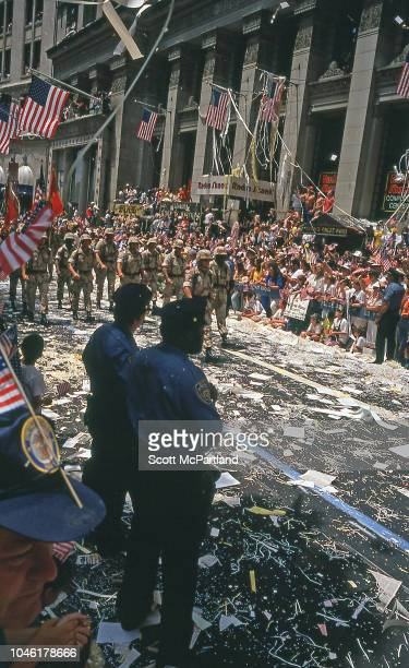 Desert Storm veterans march down Broadway's Canyon of Heroes during a ticker tape parade in their honor New York New York June 10 1991 Spectators amd...