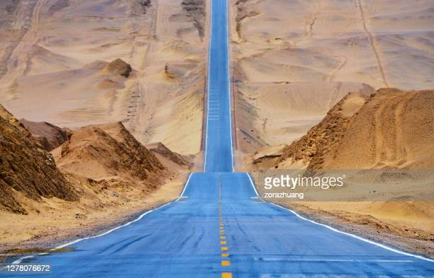 desert straight road - eternity stock pictures, royalty-free photos & images