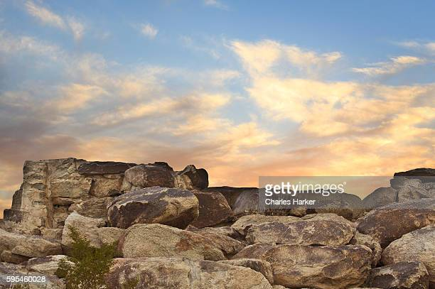 Desert Sunset Landscape with Boulders and colorful sky
