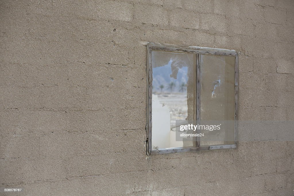 Desert view through a broken window, Dibba, UAE : Stock Photo
