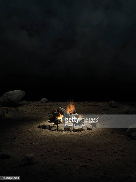 desert with campfire at night - camp fire stock photos and pictures