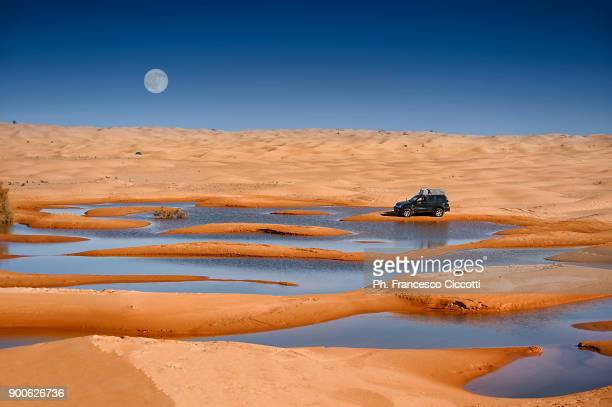 desert with moon and lake - tunisia stock pictures, royalty-free photos & images