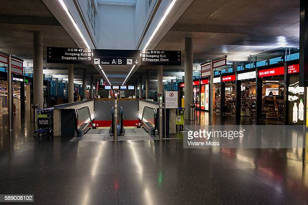 Deserted airport terminal Travel on December 25th Christmas day a holiday date Kloten airport is deserted no travelers no people empty and seemingly...