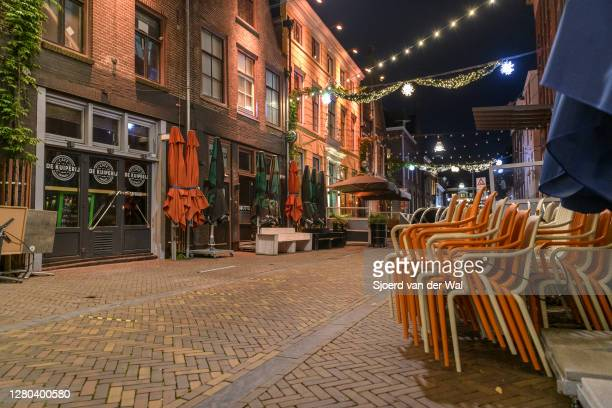 Deserted bar street with closed bars and dancings in the city center of Zwolle during the weekly shopping evening after the Dutch government...