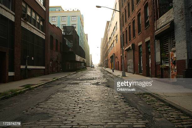 deserted brooklyn dumbo cobblestone backstreet morning - abandoned stock pictures, royalty-free photos & images