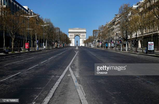Deserted ChampsElysees avenue is seen without car during the coronavirus epidemic on April 4 in Paris France The country is issuing fines for people...