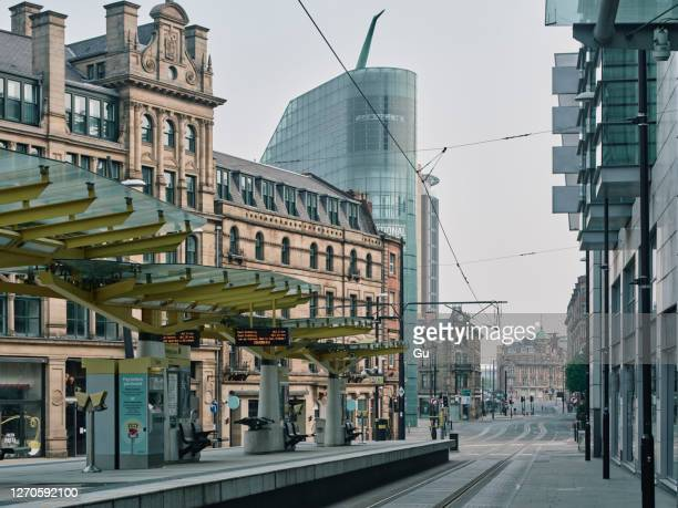 deserted city centre streets in manchester during lockdown period in the coronavirus pandemic. - manchester england stock pictures, royalty-free photos & images