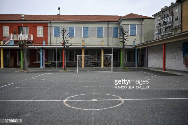 A deserted football ground is pictured in the San Giovanni Bosco Oratory on March 22 2020 in Saluzzo near Cuneo Northwestern Italy Priests and nuns...