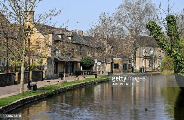 Deserted footpath ispictured in the Cotswolds village of Bourton-on-the-Water, central England,on April 11 as life in Britain continues over the...