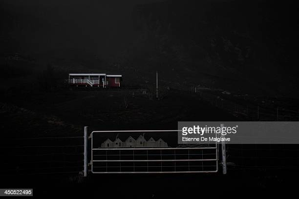 A deserted house under a dark fallout of ashes spewed by Iceland's Eyjafjallajokull volcano that blacked out visibility under the plume during the...