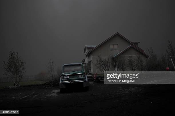 A deserted house under a dark fallout of ashes spewed by Iceland's Eyjafjallajokull volcano that blacked out visibility under the plume on May 13...