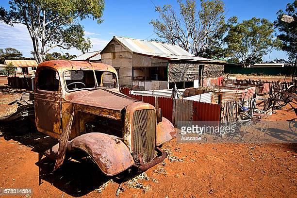Deserted miner's cottage and vehicle in a ghost town Gwalia was a goldmining town Underground mining began in 1897 at the Sons of Gwalia mine that...