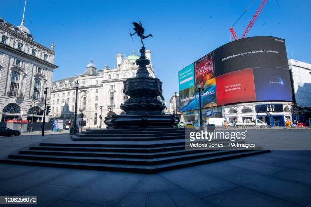 Deserted Piccadilly Circus during morning rush hour after Prime Minister Boris Johnson put the UK in lockdown to help curb the spread of the...