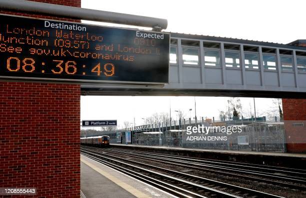 A deserted platform is pictured at the end of what would be the morning rushhour a Fleet train station in Fleet south west of London on March 30 as...