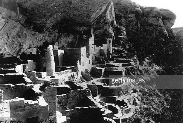 Deserted pueblo, Mesa Verde in Colorado is tucked under a rocky overhang. Pueblos are made of stone or adobe and are typical structures in this area,...
