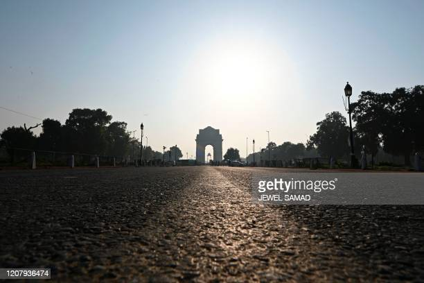 A deserted road at Rajpath in front of India Gate is seen during a oneday Janata curfew imposed amid concerns over the spread of the COVID19 novel...