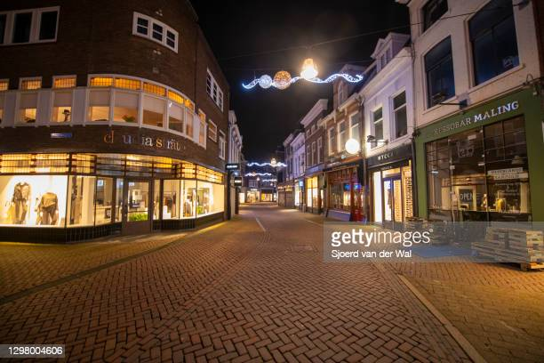 Deserted street in the city center of Zwolle during the start of the evening curfew after the Dutch government announced new measures to put a halt...