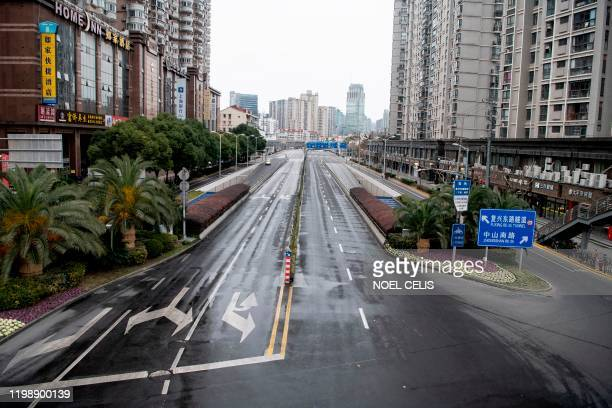 Deserted street is seen in Shanghai on February 6, 2020. - The number of confirmed infections in China's coronavirus outbreak has reached 28,018...