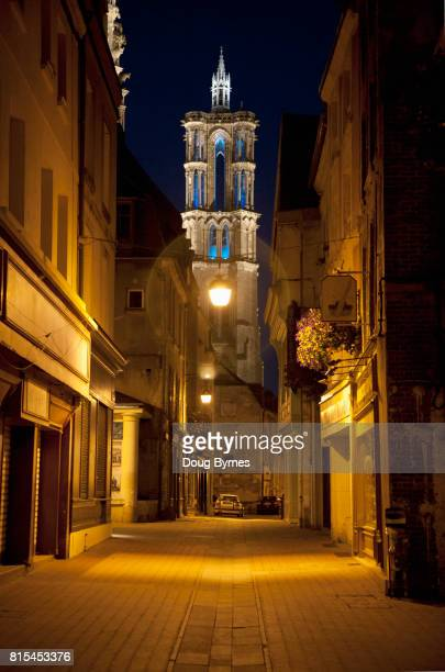 Deserted street with church in Laon at night
