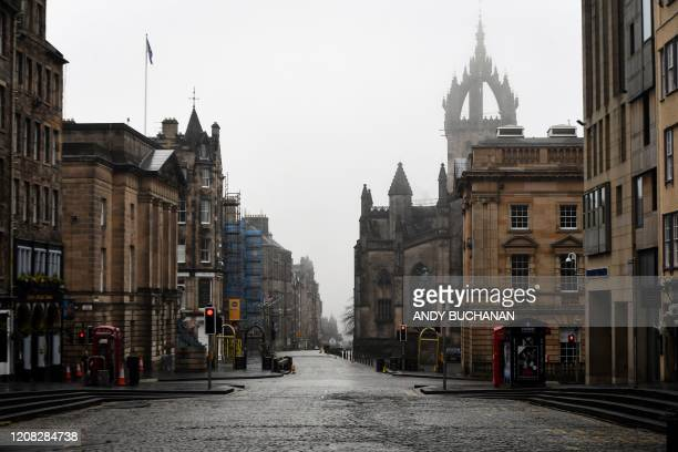 Deserted streets are seen in Edinburgh, Scotland on March 26, 2020 after the government ordered a lockdown to help stop the spread of the novel...